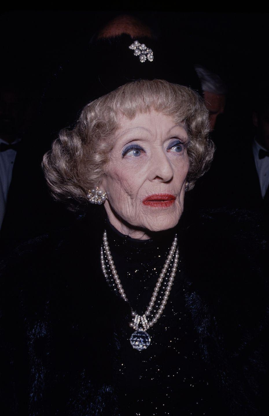 """<p>This picture shows Davis in 1988. She died on October 6, 1989 at the age of 81. Her tombstone bears the words: """"She did it the hard way,"""" which was reportedly suggested to her by <em>All About Eve </em>director Joseph L. Mankiewicz.</p>"""
