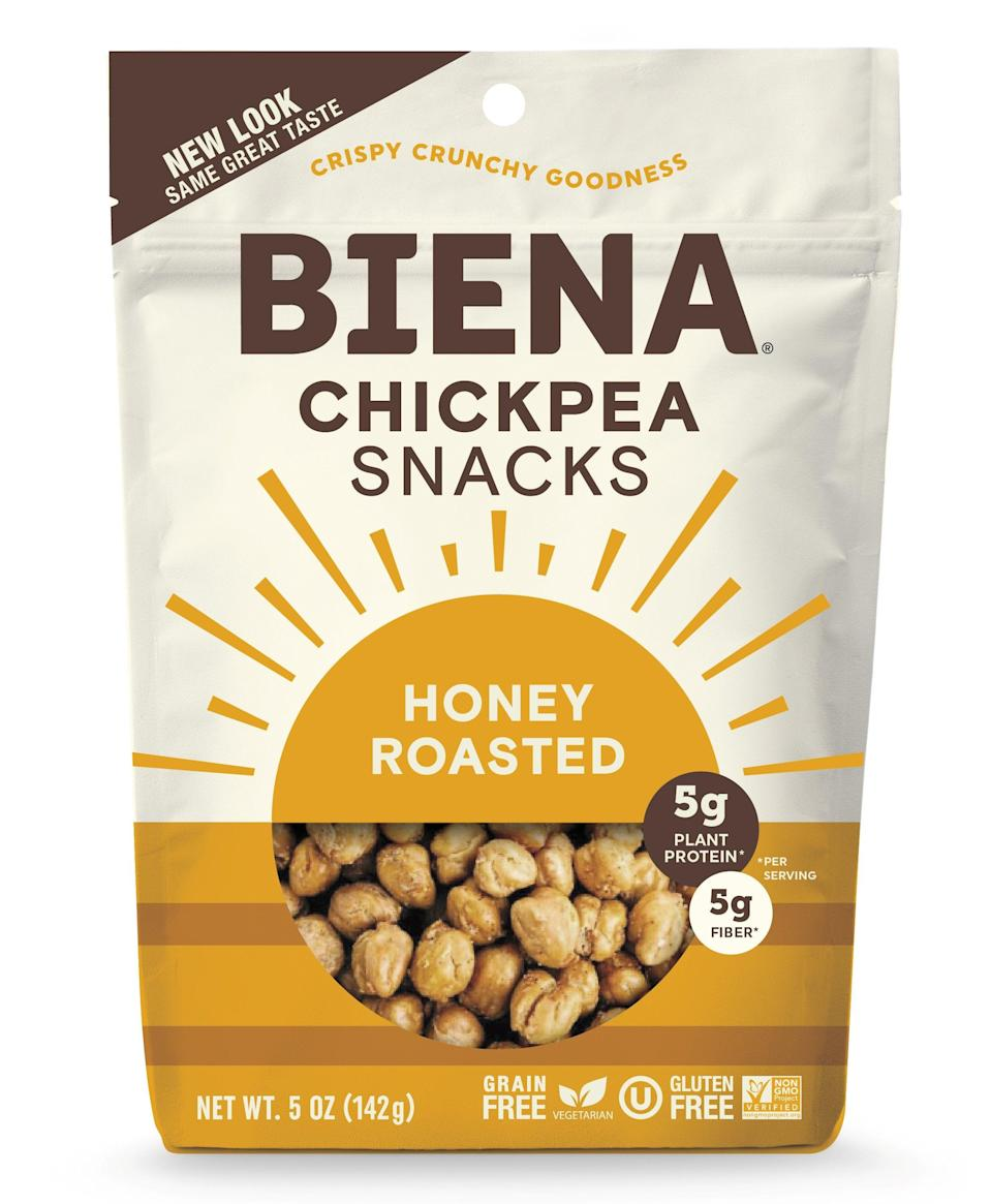 """<h2>Biena Roasted Chickpea Snacks</h2> <br>""""Not only are these delish, but they are highly nutritious and have both protein and fiber,"""" Davis says. These chickpea snacks also come in a ton of flavors, such as sea salt, honey roasted, habanero, ranch, and more to satisfy whatever taste you're craving.<br><br>Side note: You can DIY this snack by baking <a href=""""https://www.refinery29.com/en-us/2020/03/9562888/pantry-recipes-for-coronavirus"""" rel=""""nofollow noopener"""" target=""""_blank"""" data-ylk=""""slk:canned chickpeas"""" class=""""link rapid-noclick-resp"""">canned chickpeas</a> in an oven. A cup has about 12 grams of fiber.<br><br><strong>Biena Snacks</strong> Roasted Chickpea Snacks, $, available at <a href=""""https://go.skimresources.com/?id=30283X879131&url=https%3A%2F%2Fbienasnacks.com%2Fcollections%2Fclassic-roasted-chickpeas%2Fproducts%2Fhoney-roasted"""" rel=""""nofollow noopener"""" target=""""_blank"""" data-ylk=""""slk:Biena Snacks"""" class=""""link rapid-noclick-resp"""">Biena Snacks</a><br><br><br>"""
