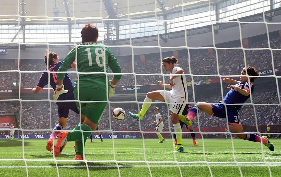 VANCOUVER, BC - JULY 05:  Carli Lloyd #10 of the United States of America scores the team's second goal against Saki Kumagai #4, Azusa Iwashimizu #3 and goalkeeper Ayumi Kaihori #18 of Japan in the FIFA Women's World Cup Canada 2015 Final at BC Place Stadium on July 5, 2015 in Vancouver, Canada.  (Photo by Dennis Grombkowski/Getty Images)