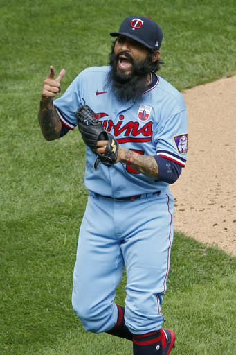 Minnesota Twins relief pitcher Sergio Romo celebrates after striking out the final batter of the Kansas City Royals at a baseball game Sunday, Aug. 16, 2020, in Minneapolis. (AP Photo/Bruce Kluckhohn)