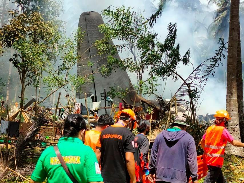 Rescuers search for bodies from the site where a Philippine military C-130 plane crashed in Patikul town, Sulu province (AP)