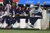 New England Patriots quarterbacks Cam Newton, left, and Jarrett Stidham sit on the bench with offensive coordinator Josh McDaniels, right, in the second half of an NFL football game against the San Francisco 49ers, Sunday, Oct. 25, 2020, in Foxborough, Mass. (AP Photo/Steven Senne)