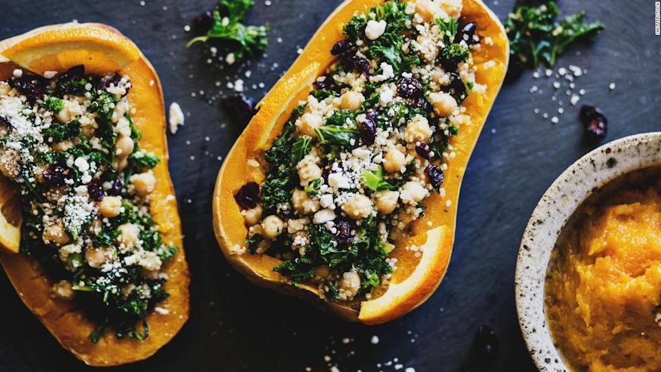 """<p>Stuffed squashes with quinoa, kale, cranberries, and chickpeas are a colorful addition to the holiday table.</p><div class=""""cnn--image__credit""""><em><small>Credit: Shutterstock / Shutterstock</small></em></div>"""