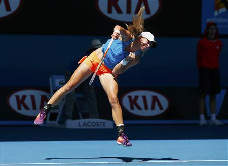 Johanna Larsson of Sweden serves to Victoria Azarenka of Belarus during their women's singles match at the Australian Open 2014 tennis tournament in Melbourne January 14, 2014. REUTERS/Petar Kujundzic