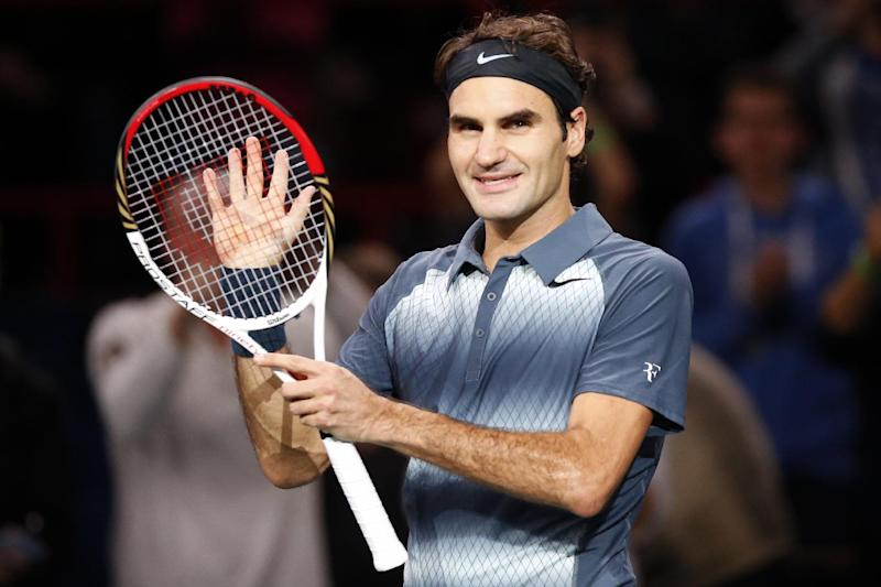 Roger Federer of Switzerland celebrates after defeating Philipp Kohlschreiber of Germany during their round of eight match, at the Paris Masters tennis at Bercy Arena in Paris, France, Thursday, Oct. 31, 2013. (AP Photo/Francois Mori)