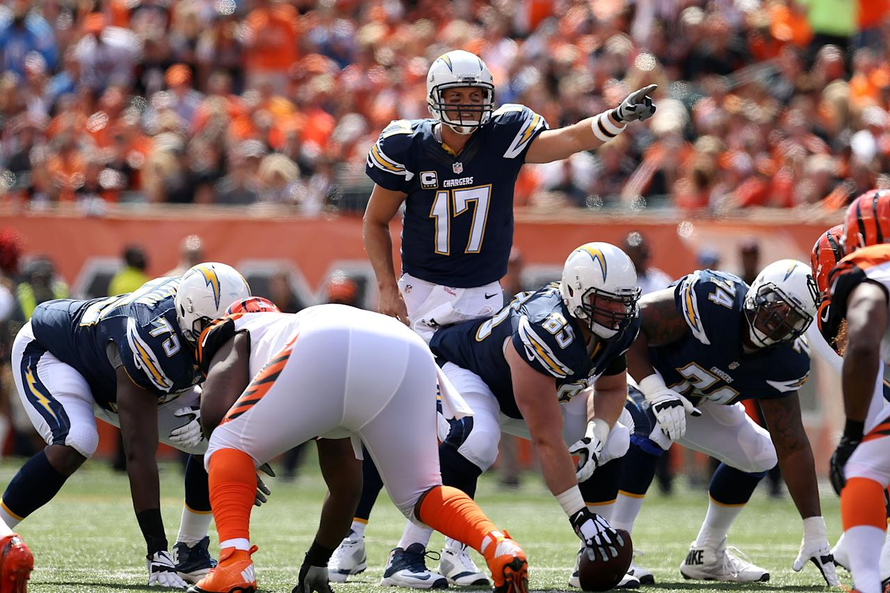 <p>Philip Rivers #17 of the Chargers calls a play at the line of scrimmage during the first quarter of the game against the Cincinnati Bengals at Paul Brown Stadium on September 20, 2015 in Cincinnati, Ohio. (Photo by Andy Lyons/Getty Images) </p>
