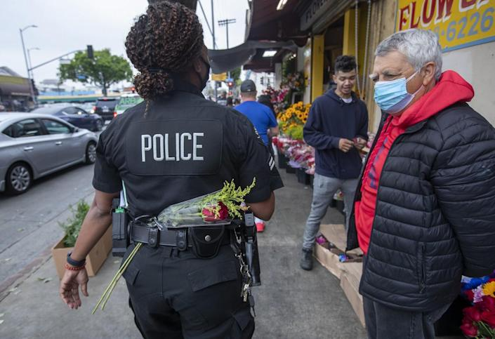 A police officer walks in the Flower District