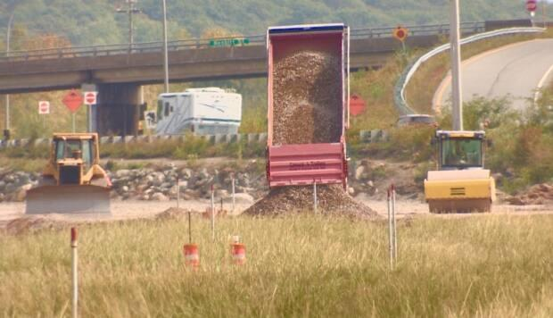 A truck dumps a load of rock last September as part of a twinning project near the Highway 101 causeway in Windsor, N.S. (Paul Palmeter/CBC - image credit)