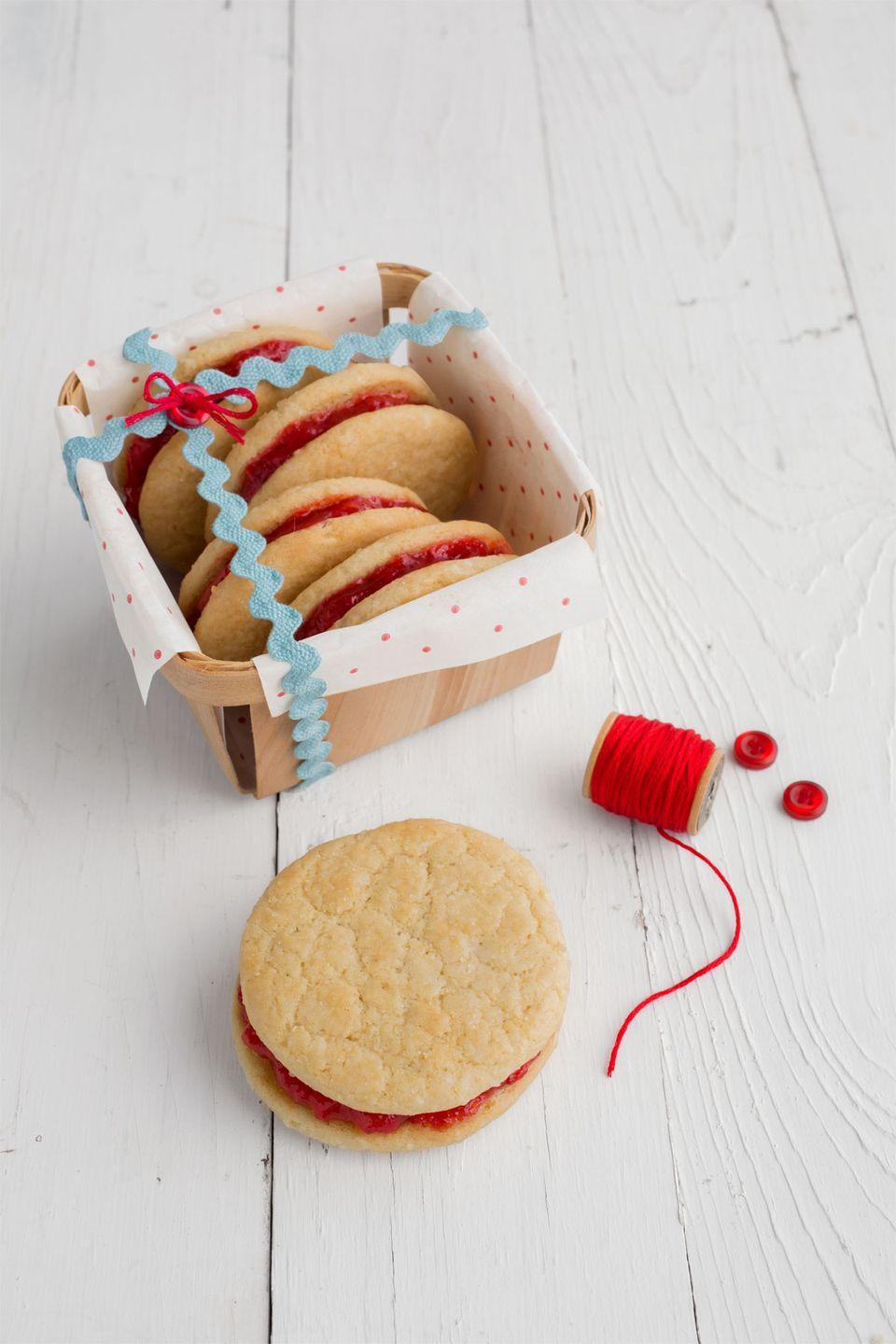 "<p>Line a berry basket with polka dot tissue paper and add cookies. Wrap with rickrack, and sew in place with a button and embroidery thread.</p><p><strong><a href=""https://www.countryliving.com/food-drinks/recipes/a36898/biscuit-jam-cookies/"" rel=""nofollow noopener"" target=""_blank"" data-ylk=""slk:Get the recipe."" class=""link rapid-noclick-resp"">Get the recipe.</a></strong></p>"