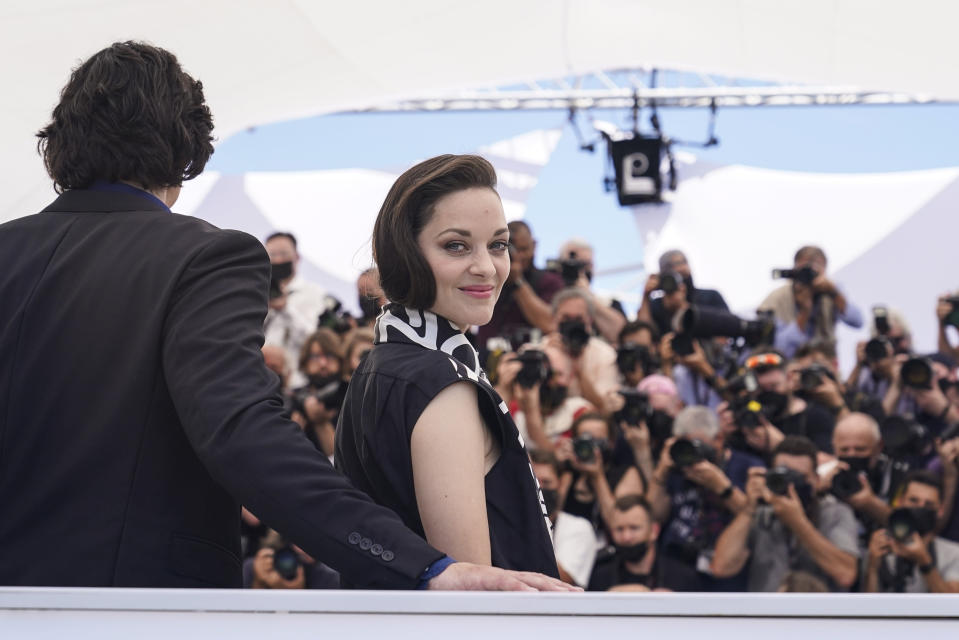 Adam Driver, left, and Marion Cotillard pose for photographers at the photo call for the film Annette at the 74th international film festival, Cannes, southern France, Tuesday, July 6, 2021. (AP Photo/Brynn Anderson)