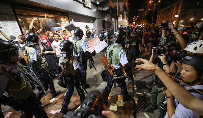 Protesters throw 'hell money' at police in Sham Shui Po. Photo: Winson Wong