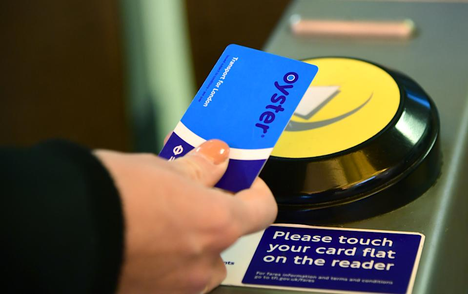 An Oyster card is used at a tube station in London. (Photo by Ian West/PA Images via Getty Images)