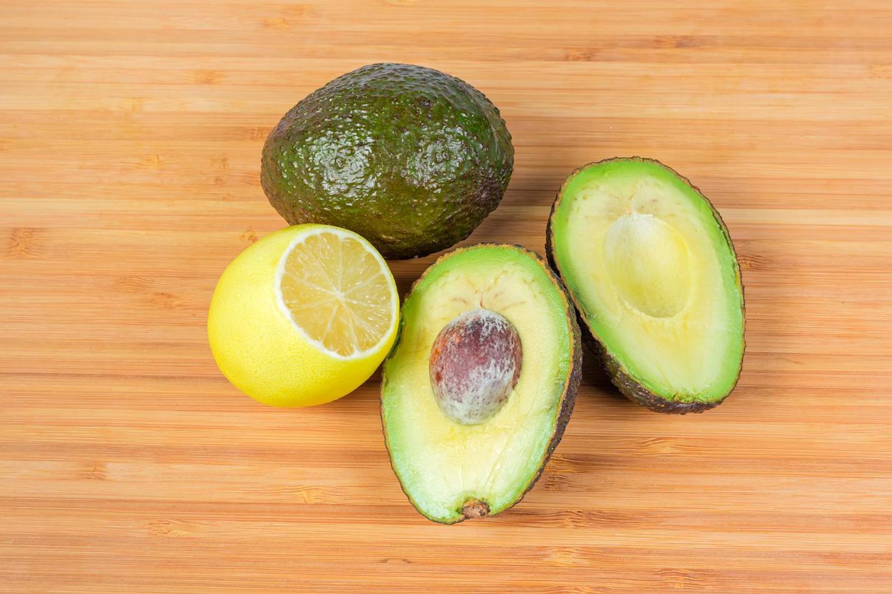 """<p>If you happen to have half an avocado left after using some to top your <a href=""""https://www.thedailymeal.com/our-50-best-burger-recipes-gallery?referrer=yahoo&category=beauty_food&include_utm=1&utm_medium=referral&utm_source=yahoo&utm_campaign=feed"""">burger</a> or chopping some avocado into your <a href=""""https://www.thedailymeal.com/best-scrambled-eggs?referrer=yahoo&category=beauty_food&include_utm=1&utm_medium=referral&utm_source=yahoo&utm_campaign=feed"""">perfectly scrambled eggs</a>, you can save the other half from oxidizing. Squeeze a bit of lemon juice on the exposed portion of the avocado. The citric acid acts as a natural preservative. Wrap the avocado tightly with plastic wrap and store it upside down in your fridge.</p>"""
