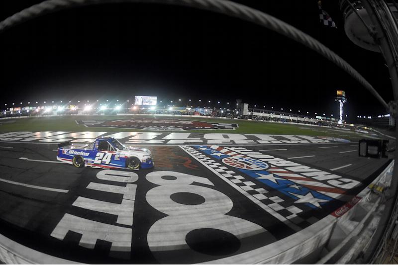 CONCORD, NORTH CAROLINA - MAY 26: Chase Elliott, driver of the #24 iRacing Chevrolet, crosses the finish line to win the NASCAR Gander Outdoors Trucks Series North Carolina Education Lottery 200 at Charlotte Motor Speedway on May 26, 2020 in Concord, North Carolina. (Photo by Jared C. Tilton/Getty Images)