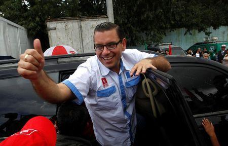 Presidential candidate Manuel Baldizon, of the political party Libertad Democratica Renovada (LIDER), gives a thumbs up in Guatemala City