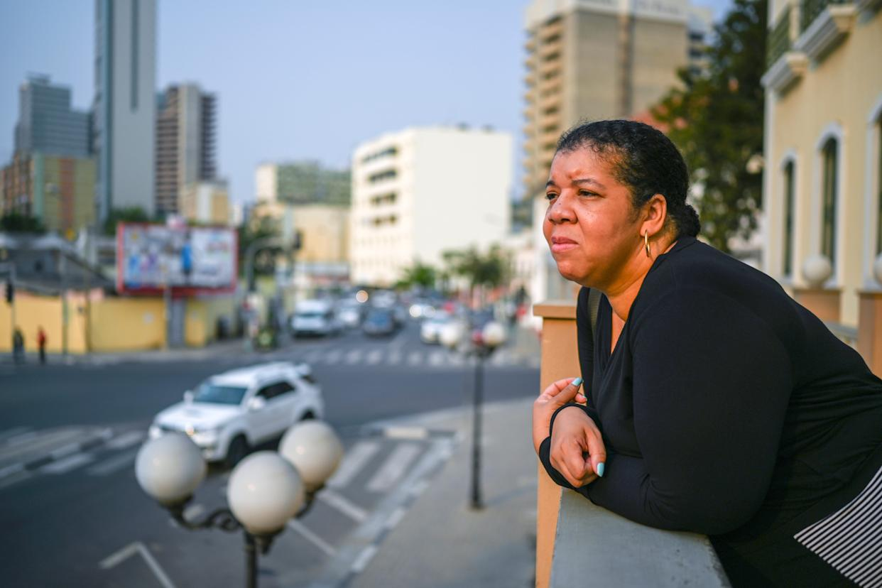 Nichelle Smith stands outside the palace of colonial-era female slaveholder Dona Ana Joaquina in downtown Luanda. Smith edits USA TODAY's Black History Month publication. Much of her research was used to take the reporting team to Angola and the origins of slavery.