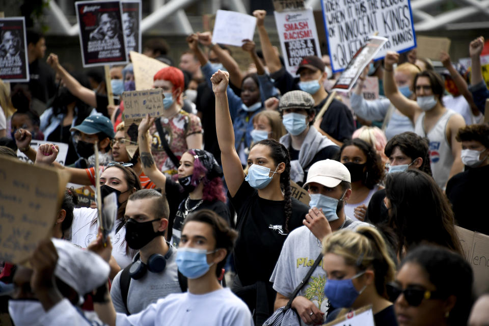 People march during a protest in London, Saturday, July 11, 2020, organised by Black Lives Matter, in the wake of the killing of George Floyd by police officers in Minneapolis, USA last month. (AP Photo/Alberto Pezzali)