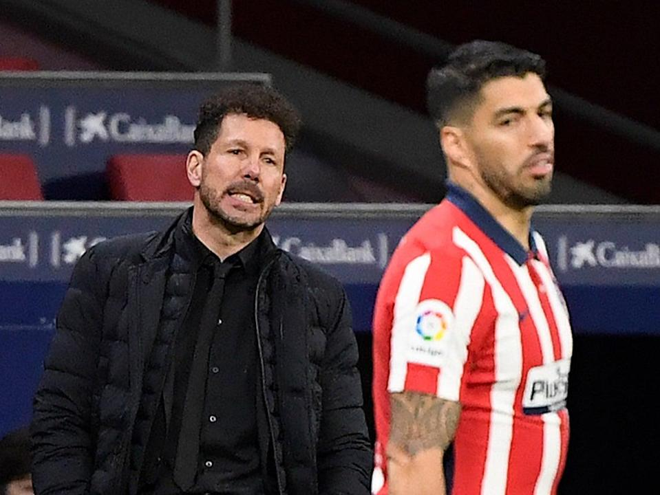 Atletico Madrid coach Diego Simeone and striker Luis Suarez (AFP via Getty Images)
