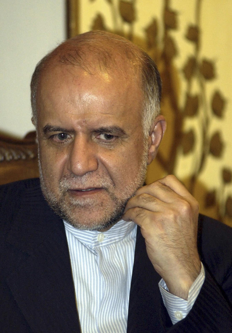 FILE-- In this Tuesday March 15, 2005 file photo, Bijan Namdar Zanganeh is seen at the Abbasi hotel in the city of Isfahan, Iran. Zanganeh who was Oil Minister and ousted when President Ahmadinejad took office in 2005, is a potential candidate for the new Oil Minister in cabinet of President elect Hasan Rouhani. (AP Photo/Hasan Sarbakhshian, File)