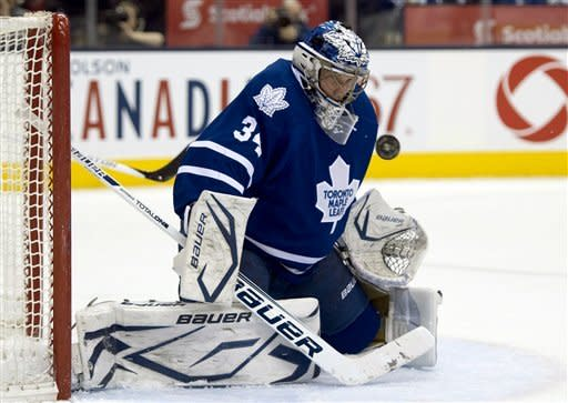 Toronto Maple Leafs goaltender James Reimer makes a save on the New Jersey Devils during the first period of their NHL hockey game, Monday, March 4, 2013, in Toronto. (AP Photo/The Canadian Press, Frank Gunn)