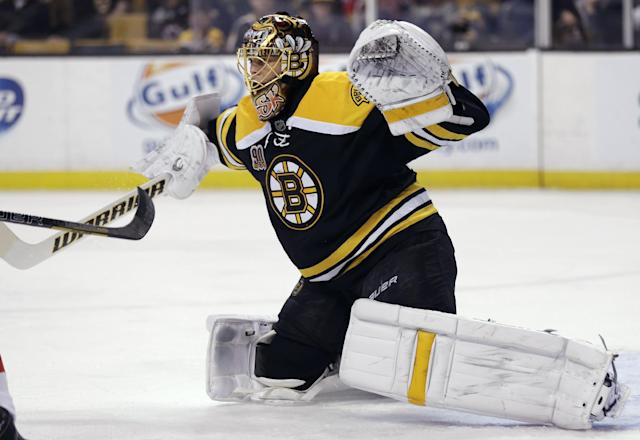 Boston Bruins goalie Tuukka Rask drops to the ice on a save against the Washington Capitals during the first period of an NHL hockey game, Thursday, March 6, 2014, in Boston. The Bruins defeated the Capitals 3-0. (AP Photo/Charles Krupa)