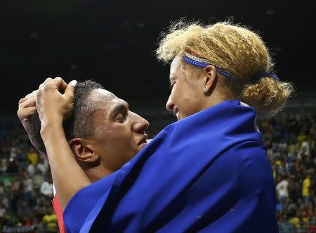 2016 Rio Olympics - Boxing - Final - Men's Super Heavy (+91kg) Final Bout 273 - Riocentro - Pavilion 6 - Rio de Janeiro, Brazil - 21/08/2016. Tony Yoka (FRA) of France celebrates with fellow gold medallist Estelle Mossely of France (FRA) after winning his bout. REUTERS/Peter Cziborra