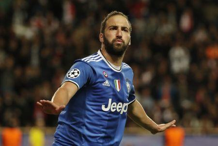 Football Soccer - AS Monaco v Juventus - UEFA Champions League Semi Final First Leg - Stade Louis II, Monaco - 3/5/17 Juventus' Gonzalo Higuain celebrates scoring their second goal Reuters / Eric Gaillard Livepic