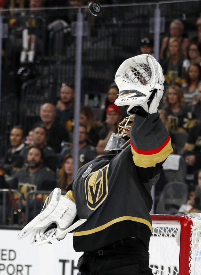 Vegas Golden Knights goaltender Marc-Andre Fleury makes a glove save during the third period in Game 2 of the team's NHL hockey Stanley Cup Finals against the Washington Capitals on Wednesday, May 30, 2018, in Las Vegas. (AP Photo/John Locher)