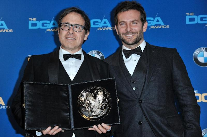 David O. Russell, left, and Bradley Cooper pose in the press room of the the 66th Annual DGA Awards Dinner at the Hyatt Regency Century Plaza Hotel on Saturday, Jan. 25, 2014, in Los Angeles, Calif. (Photo by Richard Shotwell Invision/AP)
