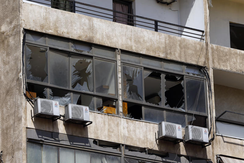Broken windows are seen on the 11-floor building that houses the media office in a stronghold of the Lebanese Hezbollah group in a southern suburb of Beirut, Lebanon, Sunday, Aug. 25, 2019. Two Israeli drones crashed in a Hezbollah stronghold in the Lebanese capital overnight without the militants firing on them, a spokesman for the group said Sunday, saying the first fell on the roof of a building housing Hezbollah's media office while the second landed in a plot behind it. (AP Photo/Bilal Hussein)