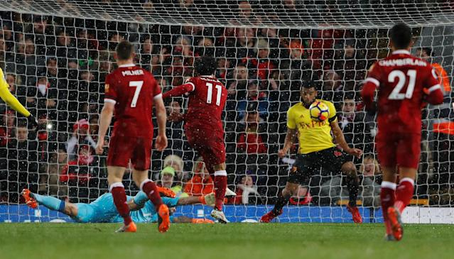 "Soccer Football - Premier League - Liverpool vs Watford - Anfield, Liverpool, Britain - March 17, 2018 Liverpool's Mohamed Salah scores their fifth goal Action Images via Reuters/Lee Smith EDITORIAL USE ONLY. No use with unauthorized audio, video, data, fixture lists, club/league logos or ""live"" services. Online in-match use limited to 75 images, no video emulation. No use in betting, games or single club/league/player publications. Please contact your account representative for further details."