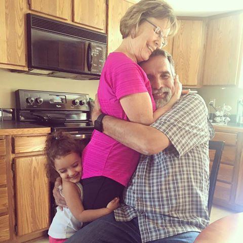 From left: Zaina with her grandparents Kathi and Myron Vierra | Courtesy the Vierra Family