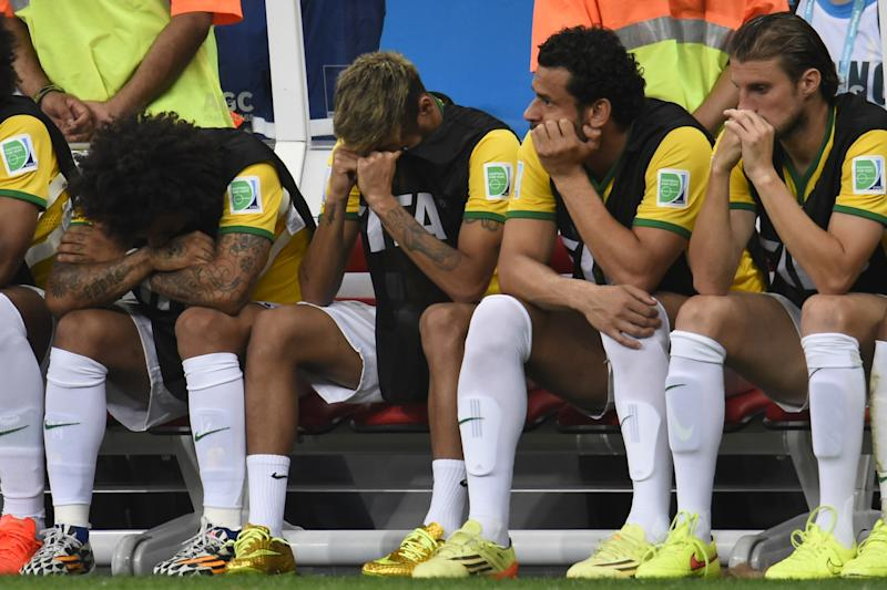 (L-R) Brazil's defender Marcelo, injured forward Neymar, forward Fred and defender Henrique react on the bench at the end of the third place play-off match between Brazil and Netherlands on July 12, 2014 (AFP Photo/Fabrice Coffrini)