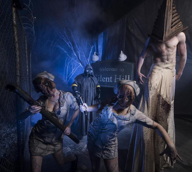 """This 2012 image provided by Universal Orlando Resort shows a scene from an attraction themed on the video game and movie """"Silent Hill"""" at Universal's Halloween Horror Nights in Orlando, Fla. The theme park also has Halloween attractions inspired by the AMC show """"The Walking Dead,"""" Alice Cooper's concept album """"Welcome to My Nightmare"""" and a House of Horrors featuring classic monsters from Universal films. (AP Photo/Universal Orlando Resort, Kevin Kolczynski)"""