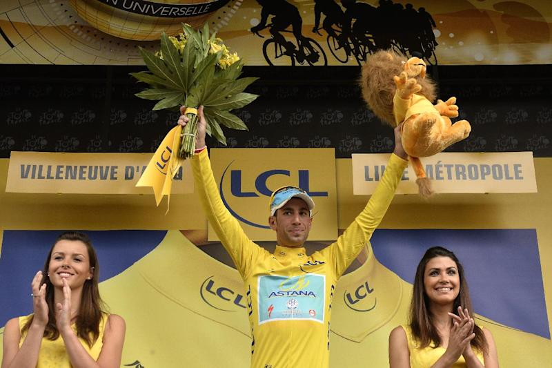 Italy's Vincenzo Nibali celebrates his overall leader yellow jersey at the end of the fourth stage of the Tour de France cycling race on July 8, 2014