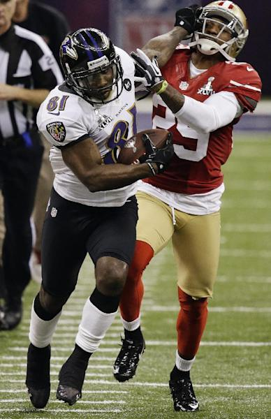 FILE - In this Feb. 3, 2013, file photo, Baltimore Ravens wide receiver Anquan Boldin (81) stiff-arms San Francisco 49ers cornerback Chris Culliver (29) during the second half of the NFL Super Bowl XLVII football game in New Orleans. The Ravens announced on Monday, March 11, that the 49ers have acquired Boldin for a sixth-round draft pick. (AP Photo/Gene Puskar, File)