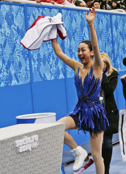Mao Asada of Japan waves to spectators as she walks to the results area after completing her routine in the women's free skate figure skating finals at the Iceberg Skating Palace during the 2014 Winter Olympics, Thursday, Feb. 20, 2014, in Sochi, Russia. (AP Photo/Bernat Armangue)