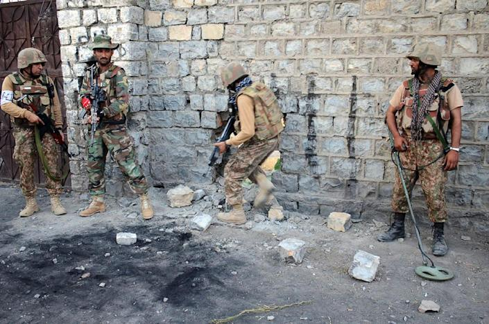 Pakistani soldiers search a house during a military operation against Taliban militants in North Waziristan. Key Haqqani members are thought to have fled back to Afghanistan (AFP Photo/)