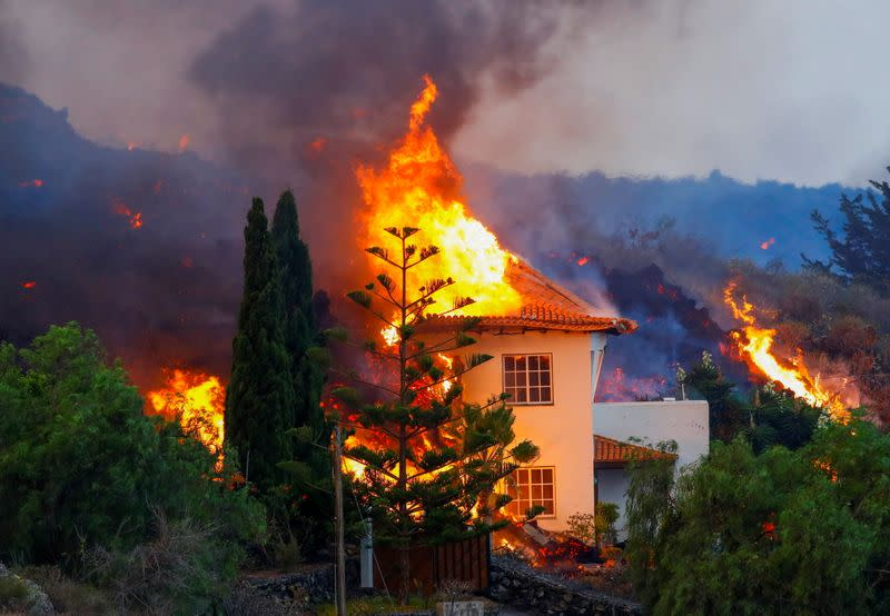 A house burns due to lava from the eruption of a volcano in Spain