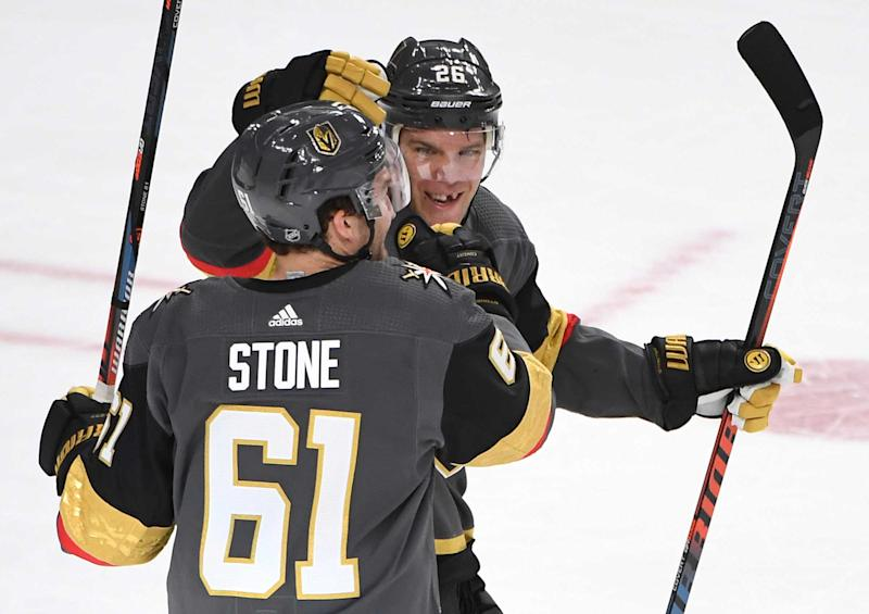 Apr 4, 2019; Las Vegas, NV, USA; Vegas Golden Knights right wing Mark Stone (61) celebrates with Vegas Golden Knights center Paul Stastny (26) after scoring a first period goal against the Arizona Coyotes at T-Mobile Arena. Mandatory Credit: Stephen R. Sylvanie-USA TODAY Sports