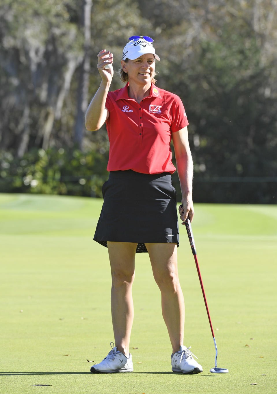 Annika Sorenstam of Sweden dressed in red and black waves to fans on the putting green during the final round of the Gainbridge LPGA golf tournament Sunday, Feb. 28, 2021, in Orlando, Fla. (AP Photo/Stan Badz)