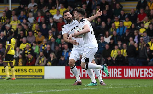 "Soccer Football - Championship - Burton Albion vs Derby County - Pirelli Stadium, Burton-on-Trent, Britain - April 14, 2018 Derby County's David Nugent celebrates scoring their first goal with Joe Ledley Action Images/John Clifton EDITORIAL USE ONLY. No use with unauthorized audio, video, data, fixture lists, club/league logos or ""live"" services. Online in-match use limited to 75 images, no video emulation. No use in betting, games or single club/league/player publications. Please contact your account representative for further details."