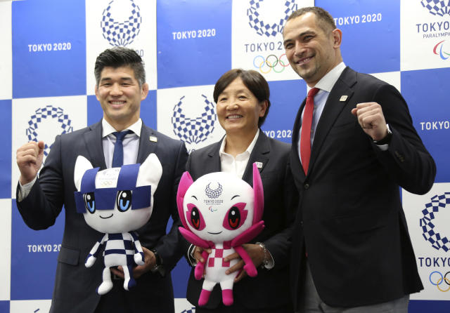 From left, Men's Judo Japan national team head coach Kosei Inoue, Women's Softball Japan national team head coach Reika Utsugi and Tokyo 2020 Sports Director Koji Murofushi pose for a photo after a press conference to unveil detailed Olympic competition schedule in Tokyo, Tuesday, April 16, 2019. For fans, athletes, and volunteers in Japan, next years Olympics in Tokyo could become known as the get-up-early games.Organizers announced Tuesday that - hoping to beat summer heat in the Japanese capital - the mens 50-meter race walk final will begin at 5:30 a.m. The mens and womens marathon final will start at 6 a.m. (AP Photo/Koji Sasahara)