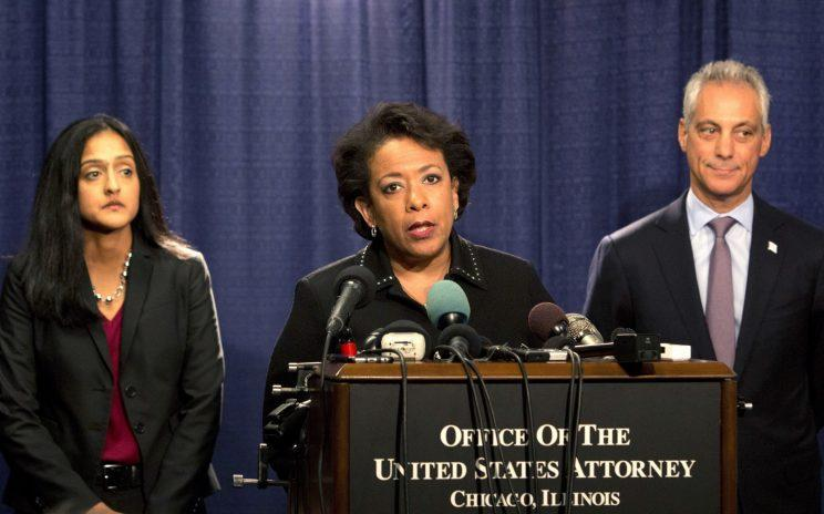 Attorney General Loretta Lynch speaks during a news conference in Chicago, accompanied by Principal Deputy Assistant Attorney General Vanita Gupta and Chicago Mayor Rahm Emanuel, on Friday. The Justice Department issued a scathing report on civil rights abuses by Chicago's police department over the years. (Photo: Teresa Crawford/AP)