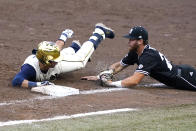 Notre Dame's Brooks Coetzee (42) safely tags first base as Mississippi State's Luke Hancock (20) dives towards him after retrieving a passed ball during the NCAA college baseball super regional game, Sunday, June 13, 2021, in Starkville, Miss. (AP Photo/Rogelio V. Solis)