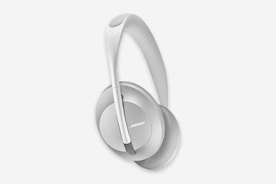 """<p>We haven't tested these yet, but the reviews are promising, with <a href=""""https://www.tomsguide.com/us/bose-700-noise-cancelling-headphones,review-6552.html"""" rel=""""nofollow noopener"""" target=""""_blank"""" data-ylk=""""slk:some tech critics suggesting"""" class=""""link rapid-noclick-resp"""">some tech critics suggesting</a> they're good enough to take the best noise-canceling headphones crown from Sony. We do know they look sleeker than Bose's QuietComforts, have a four-microphone system that simultaneously isolates your voices for calls while blocking out the noise around you, and feature 11 levels of noise cancellation. If you're loyal to all things Bose, you likely won't be disappointed by the 700—even if they're $50 more than the brand's previous iteration of noise-canceling headphones. —<em>Elaheh Nozari</em></p> <p><strong>Battery life</strong>: 20 hours</p> <p><strong>Hits</strong>: Intuitive touch controls; sleeker looking than the QuietComfort 35 II</p> <p><strong>Misses</strong>: Notably higher price point</p> <p><strong>Buy now:</strong> <a href=""""https://amzn.to/2Kp6Z38"""" rel=""""nofollow noopener"""" target=""""_blank"""" data-ylk=""""slk:$229 during Amazon Prime Day (originally $399), amazon.com"""" class=""""link rapid-noclick-resp"""">$229 during Amazon Prime Day (originally $399), amazon.com</a> or <a href=""""https://fave.co/3eMoAjF"""" rel=""""nofollow noopener"""" target=""""_blank"""" data-ylk=""""slk:$380, bose.com"""" class=""""link rapid-noclick-resp"""">$380, bose.com</a></p>"""