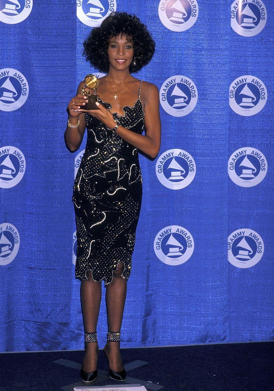 <p>The '80s were all about head-to-toe embellished looks, and Whitney Houston's rhinestone-studded ankle-strap shoes perfectly coordinated with her glittery Grammys ensemble. </p>