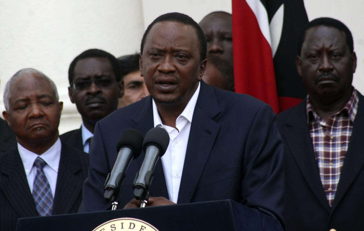 Kenya's President Uhuru Kenyatta addresses the nation on the Westgate shopping mall attack in the capital Nairobi September 22, 2013. Islamist militants were holed up with hostages on Sunday at the shopping mall in Nairobi, where at least 59 people have been killed in an attack by the al Shabaab group that opposes Kenya's participation in a peacekeeping mission in neighbouring Somalia. A volley of gunfire lasting about 30 seconds interrupted a stalemate of several hours, a Reuters witness said, speaking from near the Westgate shopping centre that has several Israeli-owned outlets and is frequented by expatriates and Kenyans. REUTERS/Stringer (KENYA - Tags: CIVIL UNREST POLITICS PROFILE)