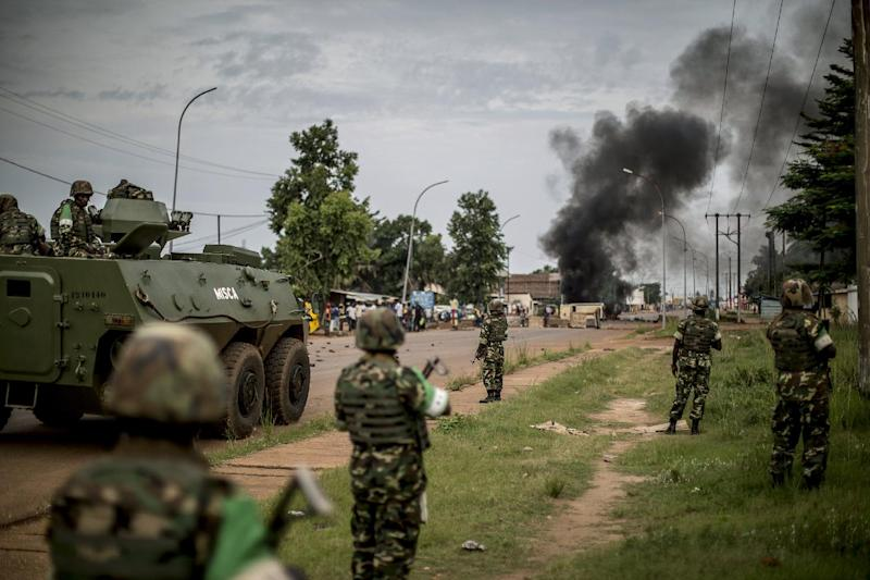 Burundian peacekeepers of the African-led International Support Mission to the Central African Republic (MISCA) patrol near a barricade of burning tyres in the Bea-Rex district of Bangui on May 29, 2014