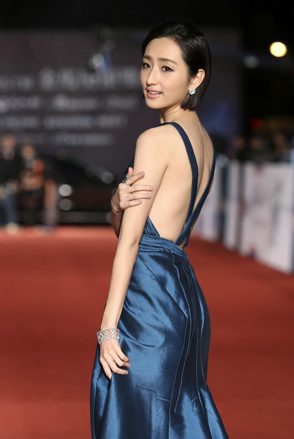 Taiwanese actress Alice Ko poses for photographers on the red carpet at the 50th Golden Horse Film Awards in Taipei November 23, 2013. REUTERS/Patrick Lin (TAIWAN - Tags: ENTERTAINMENT)